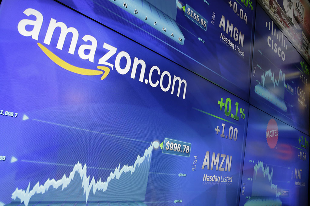 <p>Online retail giant Amazon.com traded above $1,000 a share  for the first time Tuesday, May 30, at the Nasdaq MarketSite in New York. The online retail giant has burst in market share thanks to a 38 percent increase in Amazon Prime subscriptions in the past year. (AP Photo/Richard Drew)</p>