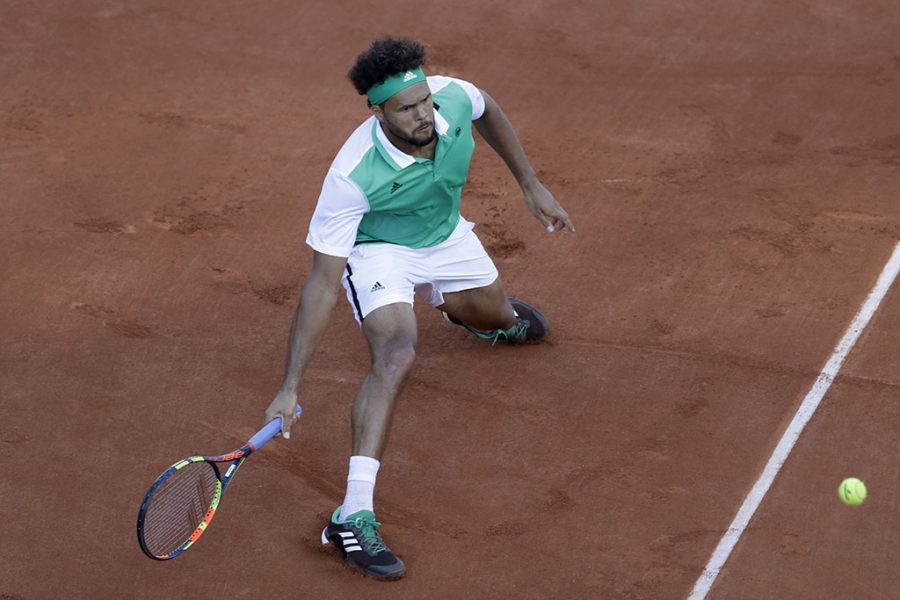 %3Cp%3EJo-Wilfried+Tsonga+makes+a+shot+against+Renzo+Olivo+at+the+French+Open+in+Paris%2C+France.+Tuesday.+%28AP+Photo%2FPetr+David+Josek%29%3C%2Fp%3E%0A