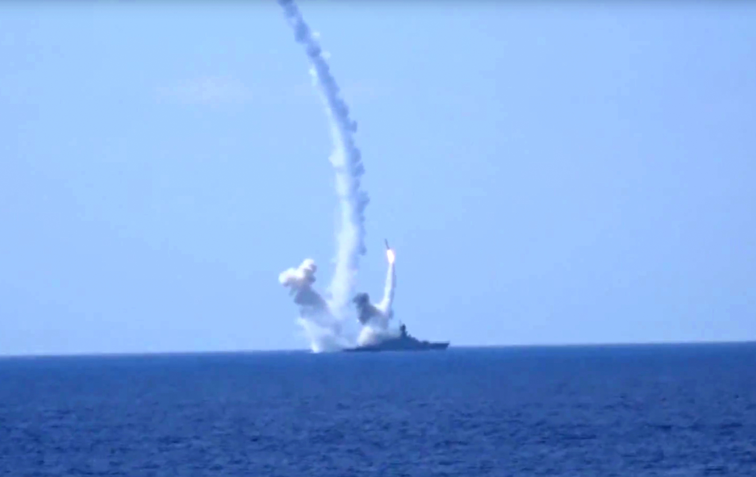 <p>FILE- In this Aug. 2016 photo provided by Russian Defense Ministry press service, long-range Kalibr cruise missiles are launched by a Russian Navy ship in the eastern Mediterranean.</p>