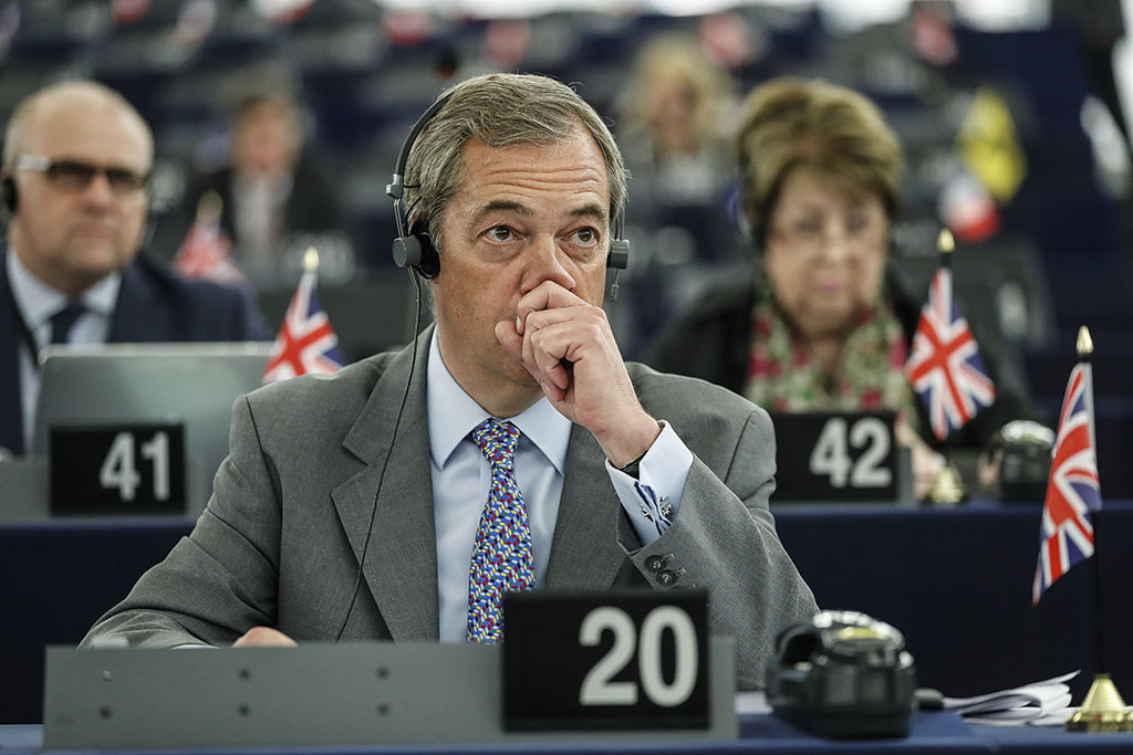 <p>The former leader of the UK Independence Party, Nigel Farage, listens during a European Parliament session in Strasbourg, France, last month. (AP Photo/Jean-Francois Badias)</p>