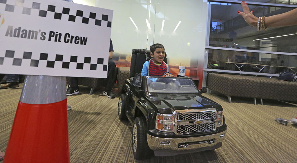<p>In this Wednesday, May 24 photo, Adam Ahmed, 6, gets excited about his opportunity to drive a toy car as he arrives on site as special needs children enjoy driving motorized toy cars at the Frisco ISD Career and Technical Education Center in Frisco, Texas. (Louis DeLuca/The Dallas Morning News via AP)</p>