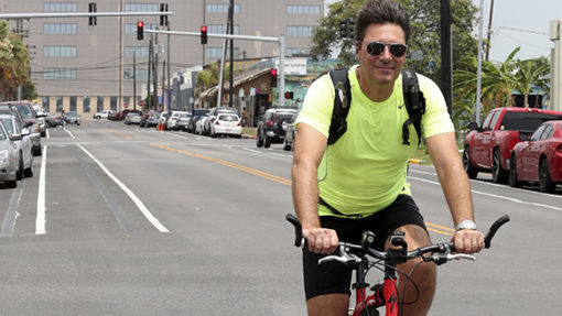 <p>Tim Tietjens, the planning and development director for Galveston and an avid cyclist, pedals south in the 19th Street bike lane. He is working with the Intermodal Transportation Committee to improve the city's biking plan. (Jennifer Reynolds/The Galveston County Daily News via AP)</p>