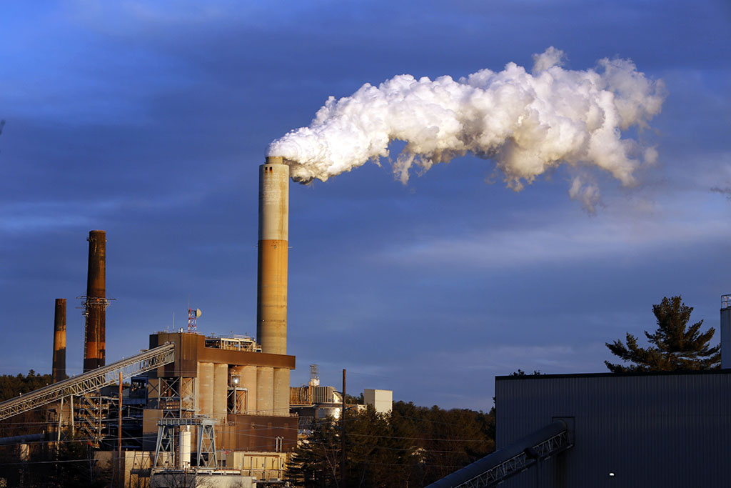 <p>In this Jan. 20, 2015 file photo, a plume of steam billows from the coal-fired Merrimack Station in Bow, New Hampshire. President Donald Trump may abandon U.S. pledges to reduce carbon emissions, but global economic realities ensure he is unlikely to reverse the accelerating push to adopt cleaner forms of energy. (AP Photo/Jim Cole, File)</p>