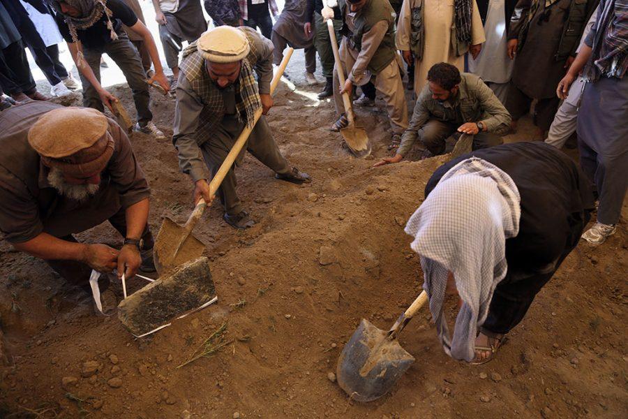 %3Cp%3EAfghans+bury+a+victim+of+Wednesday%27s+massive+bombing+in+the+capital%2C+Kabul.+%28AP+Photo%2FRahmat+Gul%29%3C%2Fp%3E%0A