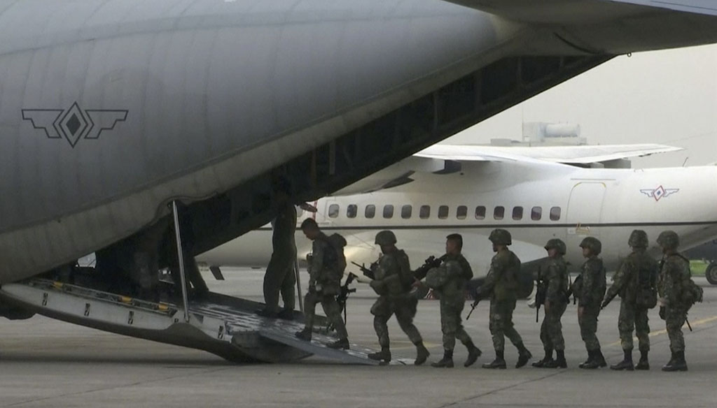 <p>Marines board a transport plane in Manila, Philippines. A marine battalion left an air force base in Manila on deployment to the southern city of Marawi where ongoing violence has killed scores of people. (AP Photo)</p>