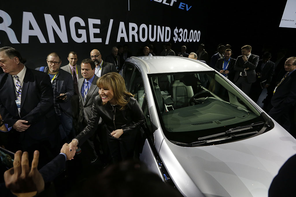 <p>General Motors Co. CEO Mary Barra stands next to the Chevrolet Bolt EV electric car at CES International in Las Vegas. Tesla and General Motors have a budding rivalry that could help determine whether Detroit or Silicon Valley sets the course for the future of the auto industry. Right now Wall Street is favoring the upstart led by flamboyant Elon Musk to the established icon headed by the more restrained Mary Barra. (AP Photo/Gregory Bull, File)</p>