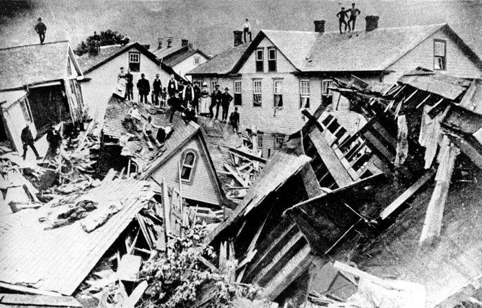 Citizens stand atop the ruins of houses destroyed in the 1889 file photo showing the aftermath of the Johnstown, Pennsylvania  flood. The historic disaster's 125th anniversary is May 31, 2014.
