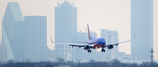 A Southwest Airlines jet plane lines up for a landing at Love Field in Dallas, where the company is headquartered.