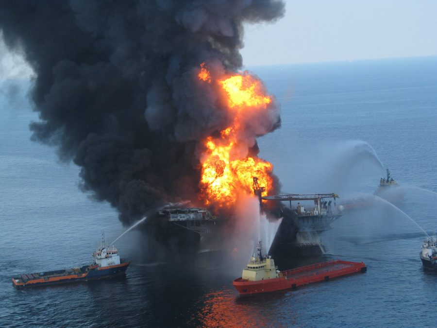Anchor-handling+tugboats+battle+the+blazing+remnants+of+the+off+shore+oil+rig+Deepwater+Horizon.+A+Coast+Guard+MH-65C+dolphin+rescue+helicopter+and+crew+document+the+fire+aboard+the+mobile+offshore+drilling+unit+Deepwater+Horizon%2C+while+searching+for+survivors.+Multiple+Coast+Guard+helicopters%2C+planes+and+cutters+responded+to+rescue+the+Deepwater+Horizon%27s+126+person+crew.+++%28April+21%2C+2010+%2F+US+Coast+Guard