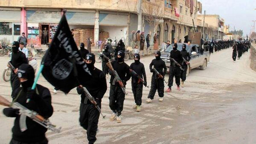 This image posted on a militant website on Tuesday, Jan. 14, 2014, shows fighters from the Islamic State group, marching in Raqqa, Syria. (Militant Website via AP)