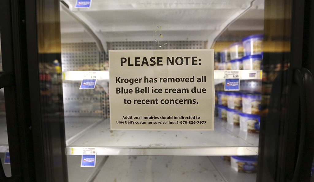 In this April 21, 2015 file photo, a sign explains why shelves sit empty of Blue Bell ice cream at a grocery store in Dallas. Blue Bell Creameries will lay off more than a third of its workforce following a series of listeria illnesses linked to its ice cream that prompted a nationwide recall, the Texas company announced Friday, May 15, 2015 (AP Photo/LM Otero, File)