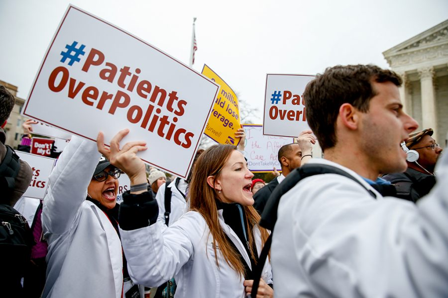 In this March 4, 2015 file photo, demonstrators chant during  health care rally outside the Supreme Court in Washington. The Supreme Court could wipe away health insurance for millions of Americans when it resolves the latest high court fight over President Barack Obama's health overhaul. But would the court take away a benefit from so many people, and should the justices even consider the consequences?  (AP Photo/Andrew Harnik, File)