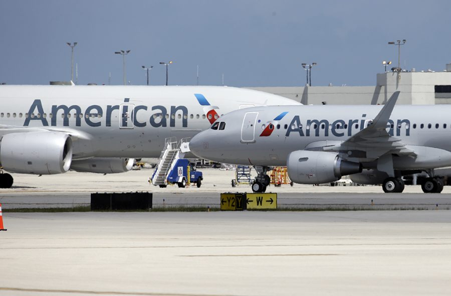 An American Airlines aircraft taxis to the gate at Miami International Airport, Wednesday, May 27, 2015, in Miami. (AP Photo/Lynne Sladky)