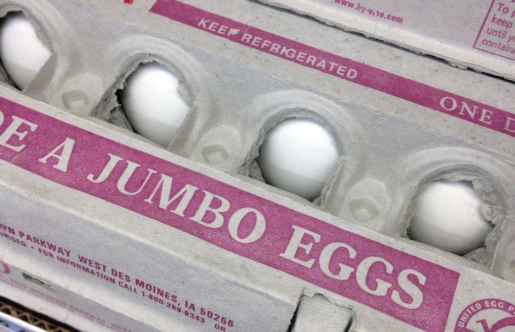 This Nov. 25, 2014, file photo, shows eggs for sale in a Des Moines, Iowa, grocery store. Egg prices reached record levels on Friday, May 22, 2015, after a bird flu outbreak decimated a flock, leading to the death of more than 20 million egg-laying hens over the last month in the top producing state of Iowa. (AP Photo/Charlie Neibergall)