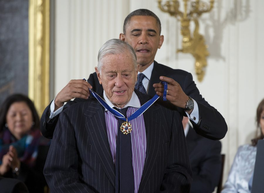 President Barack Obama awards former Washington Post executive editor Ben Bradlee with the Presidential Medal of Freedom, Wednesday, Nov. 20, 2013, during a ceremony in the East Room of the White House in Washington. (AP Photo/ Evan Vucci)