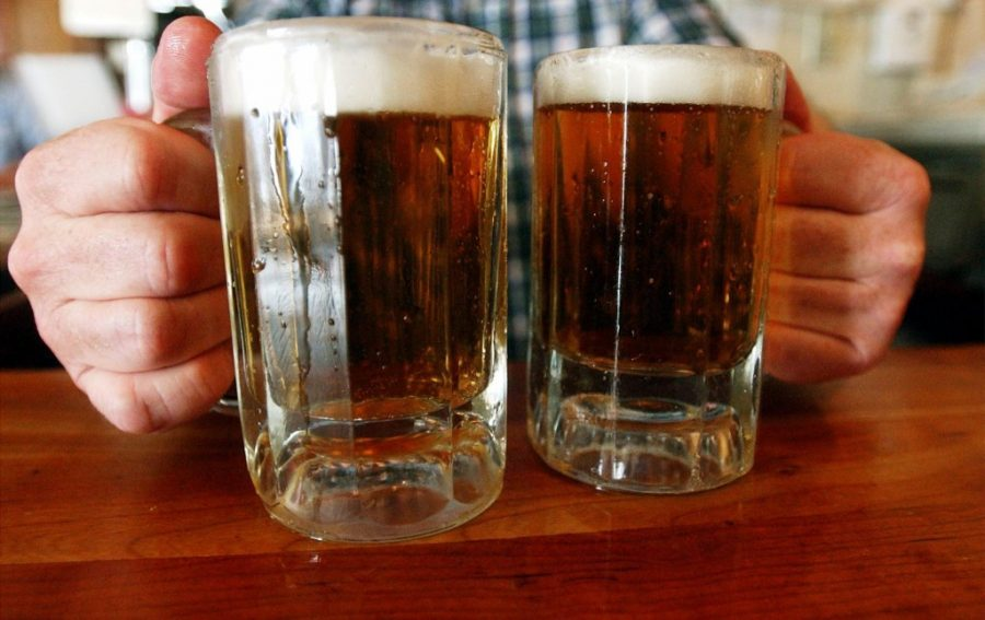 A bartender serves two mugs of beer at a tavern in Montpelier, Vt in this  June 29, 2004 photo. Alcohol problems affect almost 33 million adults and most have never sought treatment.  (AP Photo/Toby Talbot)