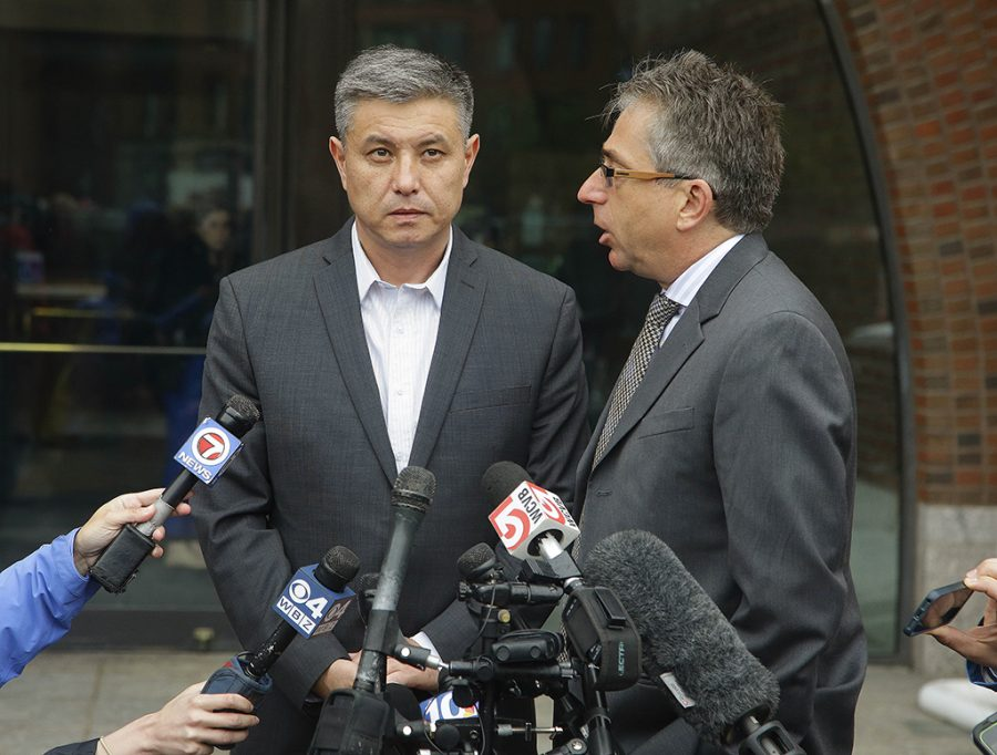 Murat Kadyrbayev, left, the father of Dias Kadyrbayev, 21, stands outside Federal court with his interpreter, Alexander Tetradze, Tuesday, June 2, 2015, answering reporters questions about the sentencing of his son, a college friend of Boston Marathon bomber Dzhokhar Tsarnaev, sentenced Tuesday to six years in prison after he apologized to the victims and their families for not calling police when he recognized photos of Tsarnaev as a suspect Tuesday, June 2, 2015, in Boston. Kadyrbayev, 21, pleaded guilty last year to obstruction of justice and conspiracy charges for removing items from Tsarnaevs dorm room after recognizing his friend in photos released by the FBI. (AP Photo/Stephan Savoia)