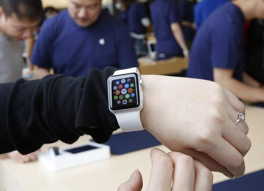 A customer tries on an Apple Watch at an Apple Store in Hong Kong on April 10, 2015. Two months after Apple began taking online orders for its newest product, the company on Thursday, June 4, 2015 said that it will begin selling some models in its retail stores in two weeks. (AP Photo/Kin Cheung, File)
