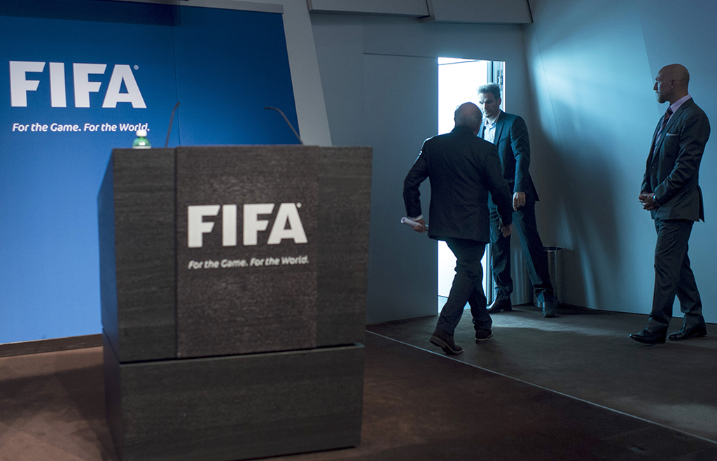FIFA President Sepp Blatter leaves after speaking at a press conference at the FIFA headquarters in Zurich, Switzerland, Tuesday, June 2, 2015. Sepp Blatter says he will resign from his position amid corruption scandal and is promising to call for fresh elections to choose a successor. (Ennio Leanza/Keystone via AP)
