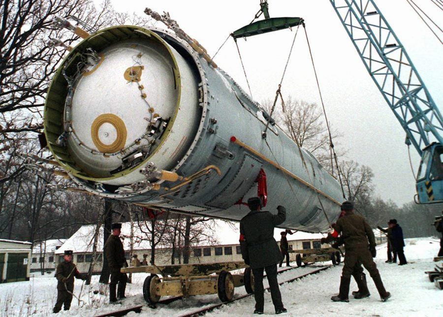 In this Dec. 24, 1997 file photo, soldiers prepare to destroy a ballistic SS-19 missile in the yard of the largest former Soviet military rocket base in Vakulenchuk, Ukraine. (AP Photo, File)