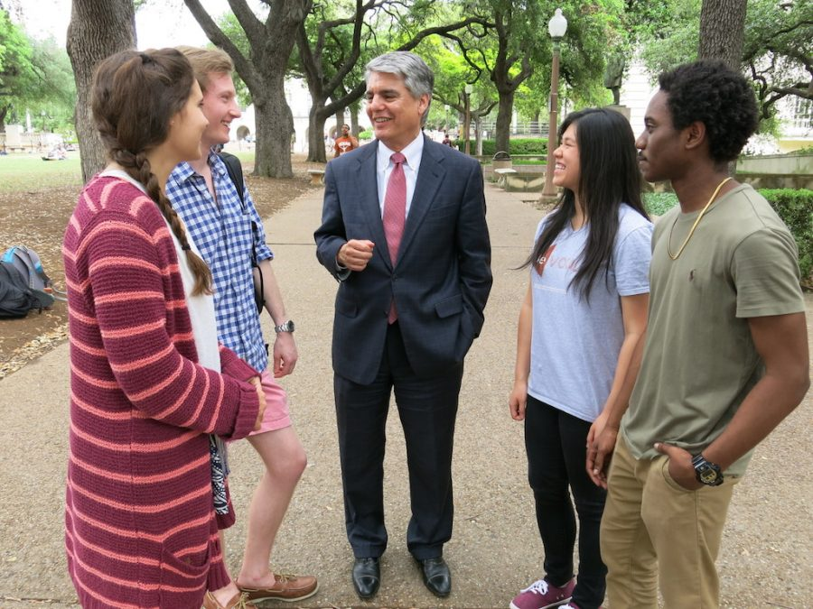 Greg Fenves, the president of the University of Texas, center, talks with students. (University of Texas)