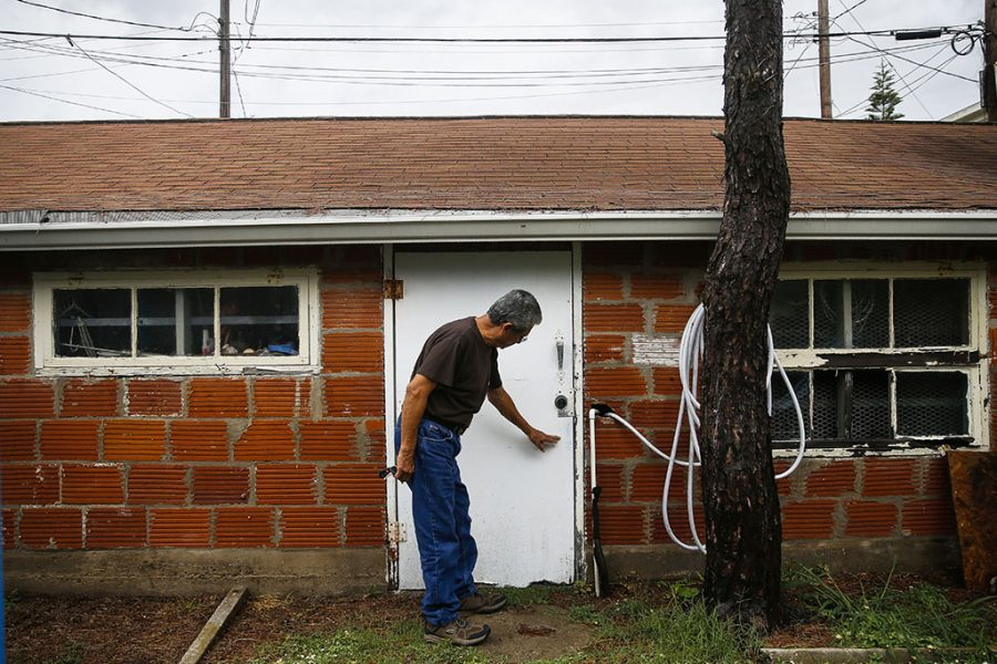 Lalo Ojeda points at the water line Hurricane Ike left on his garage in Galveston, Texas. Due to rising sea levels, Ojeda is watching the Atlantic hurricane season that begins Thursday with more concern than usual. ( Michael Ciaglo/Houston Chronicle via AP)