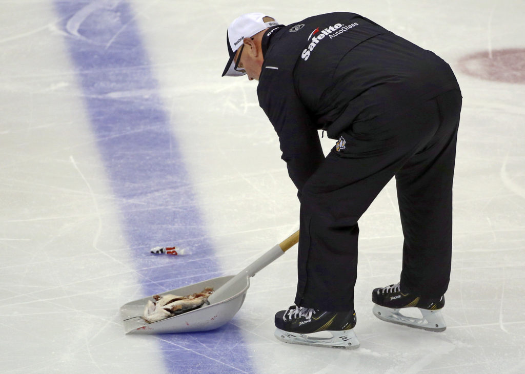 <p>An ice worker removes a fish during the second period of Game 1 of the NHL hockey Stanley Cup Finals between the Pittsburgh Penguins and Nashville Predators on May 29.</p>