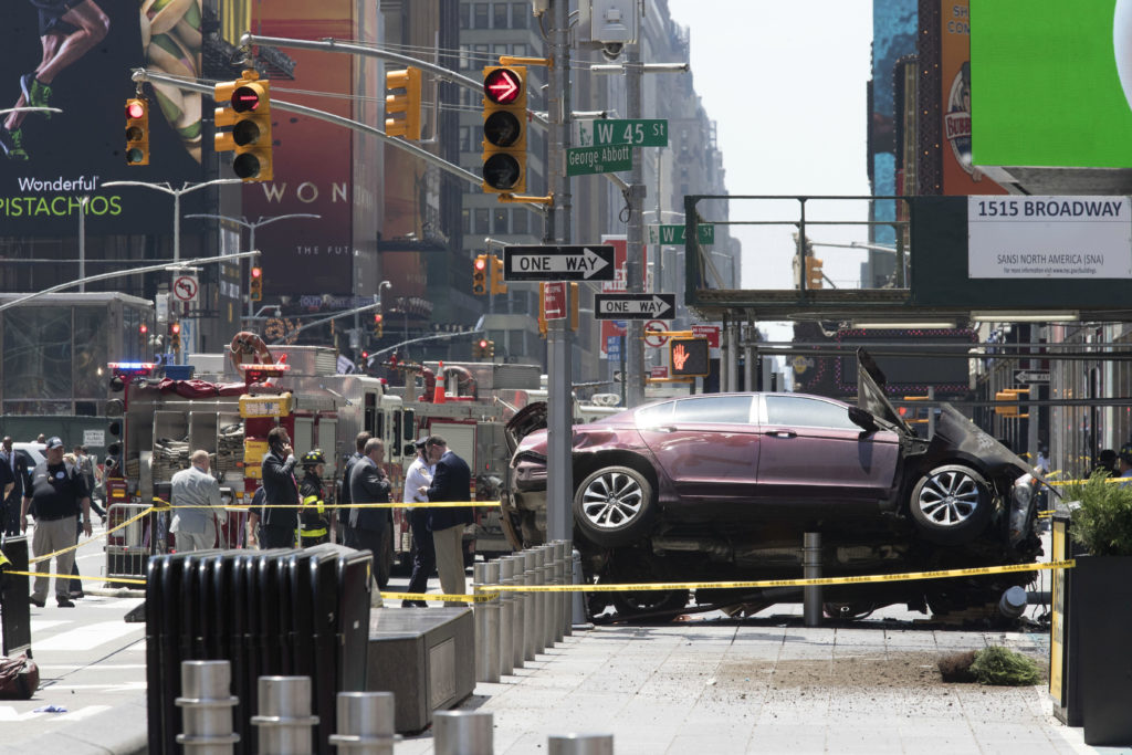 <p>FILE - In this Thursday, May 18, 2017 file photo, a car rests on a security barrier in New York's Times Square after driving through a crowd of pedestrians, injuring at least a dozen people. A three-foot-tall piece of stainless steel in the ground ultimately stopped a speeding Honda Accord as it barreled down the crowded sidewalks of Times Square this week. The vehicle rampage that killed a teenage tourist in New York's Times Square is spurring calls to further restrict cars from the so-called Crossroads of the World. (AP Photo/Mary Altaffer, File)</p>