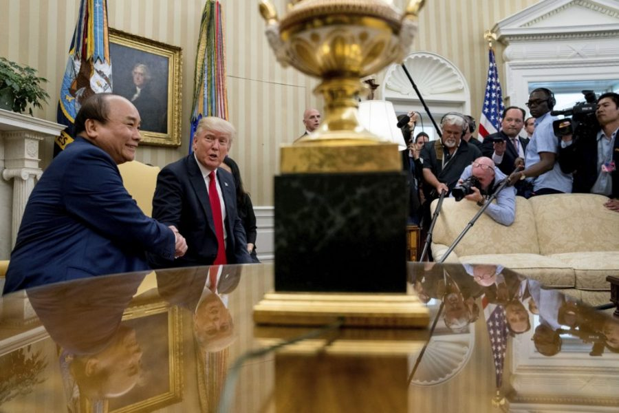 President Donald Trump and Vietnamese Prime Minister Nguyen Xuan Phuc shake hands during their meeting in the Oval Office of the White House in Washington, Wednesday, May 31, 2017. (AP Photo/Andrew Harnik)