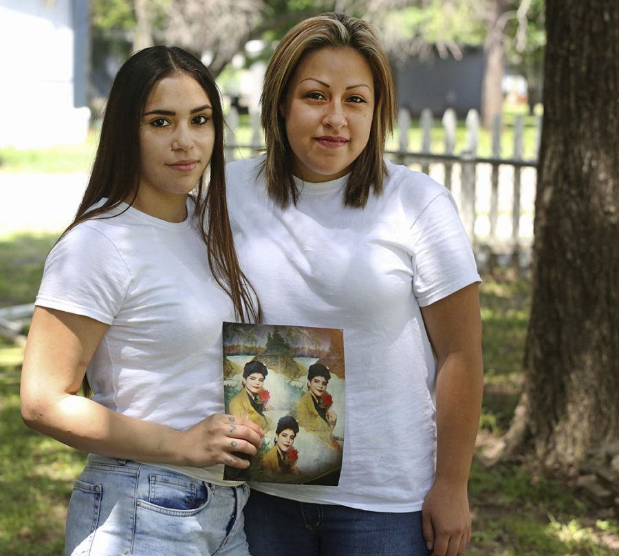 Daisy Serrano, left, with a photo of her mother and her cousin Dulce Dominguez, who she was reunited with recently, in Dallas on May 26. (Louis DeLuca/The Dallas Morning News via AP)
