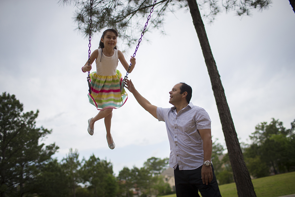 <p>David Soto pushes his daughter Paola Soto, 9, as she swings, April 1, in The Woodlands, Texas. David Soto is moving his family back to Mexico after seven years in The Woodlands. (Marie D. De Jesus/Houston Chronicle via AP)</p>