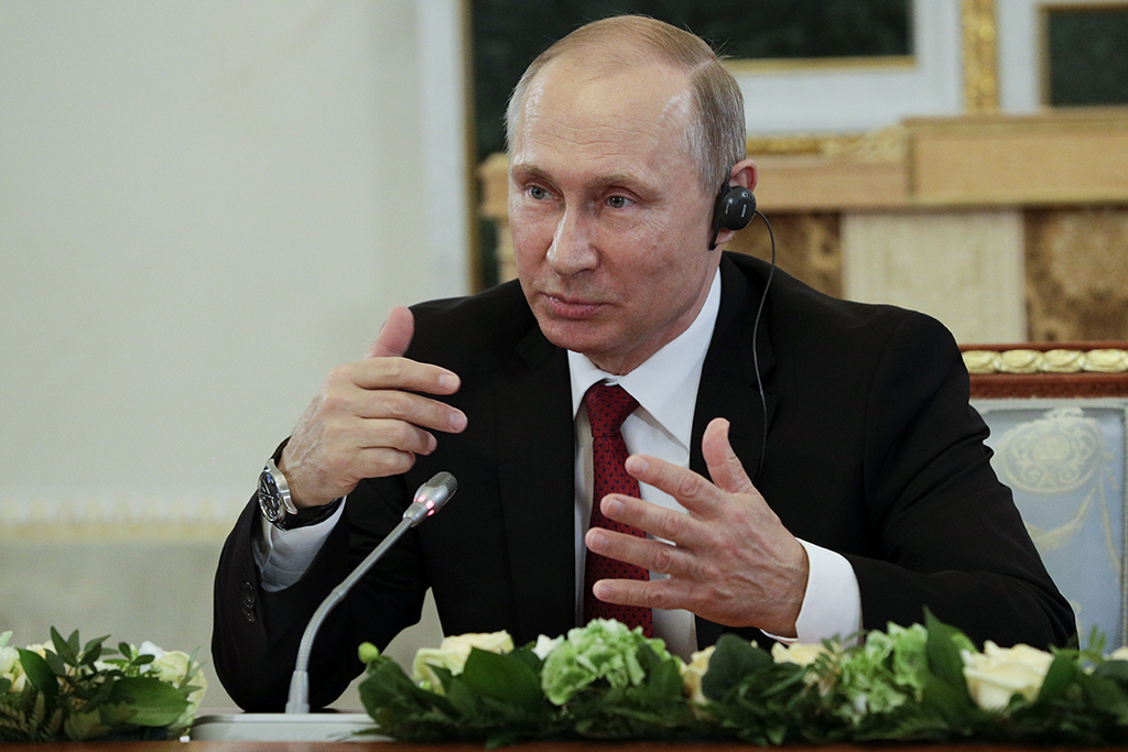 <p>Russian President Vladimir Putin speaks at a meeting with heads of international news agencies at the St. Petersburg International Economic Forum in St. Petersburg, Russia, on June 1. (AP Photo/Dmitri Lovetsky)</p>