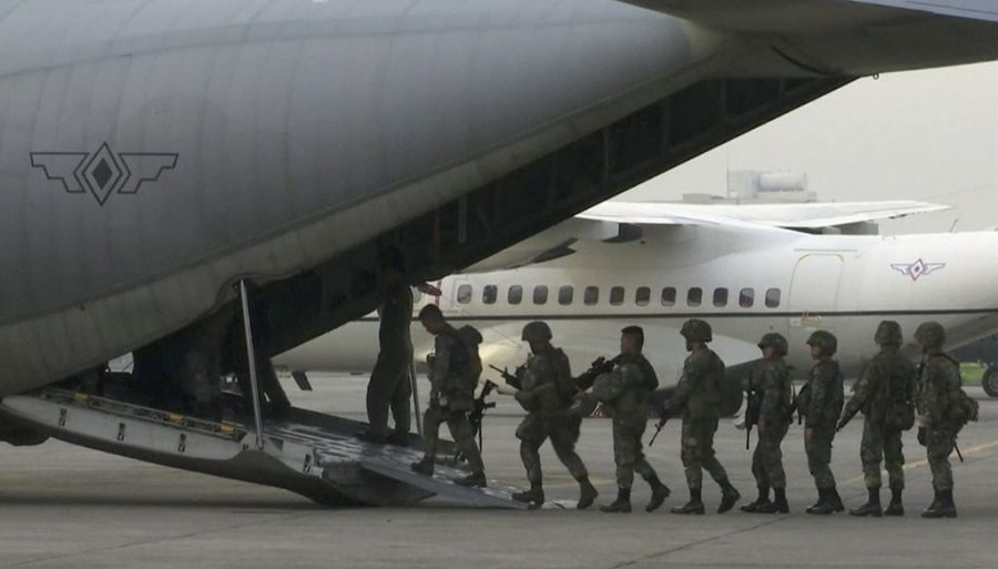 Marines board a transport plane in Manila, Philippines. A marine battalion left an air force base in Manila on deployment to the southern city of Marawi where ongoing violence has killed scores of people. (AP Photo)