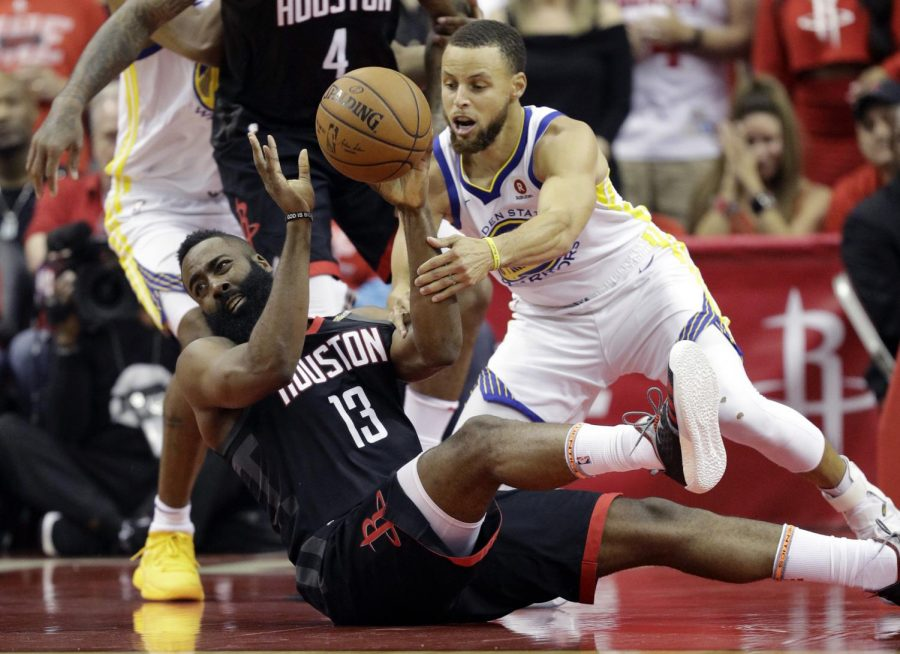 Houston Rockets guard James Harden (13) and Golden State Warriors guard Stephen Curry (30) scramble for a loose ball