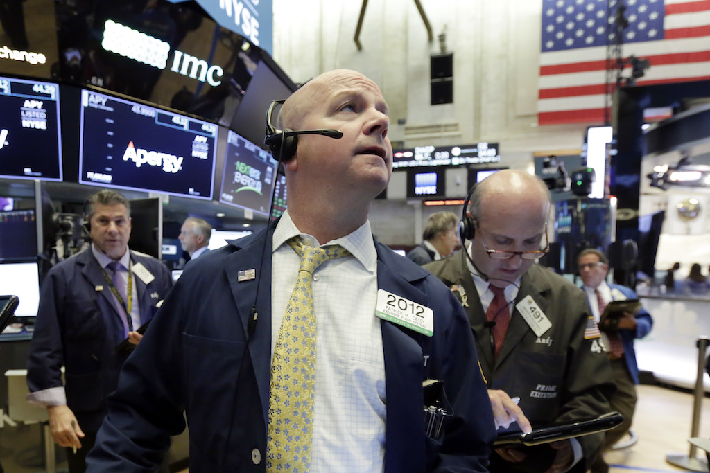 Trader Patrick Casey, center, works on the floor of the New York Stock Exchange, Tuesday, May 29, 2018. U.S. stocks are opening lower, following sharp drops in Europe triggered by political uncertainty in Italy.