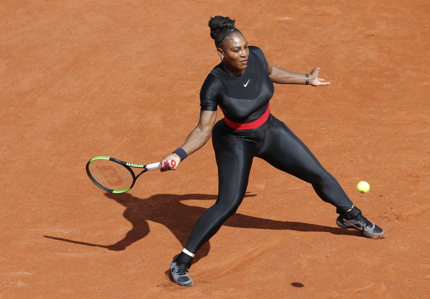 Serena Williams of the U.S. returns a shot against Krystyna Pliskova of the Czech Republic during their first round match of the French Open tennis tournament at the Roland Garros stadium in Paris, France, Tuesday, May 29, 2018.