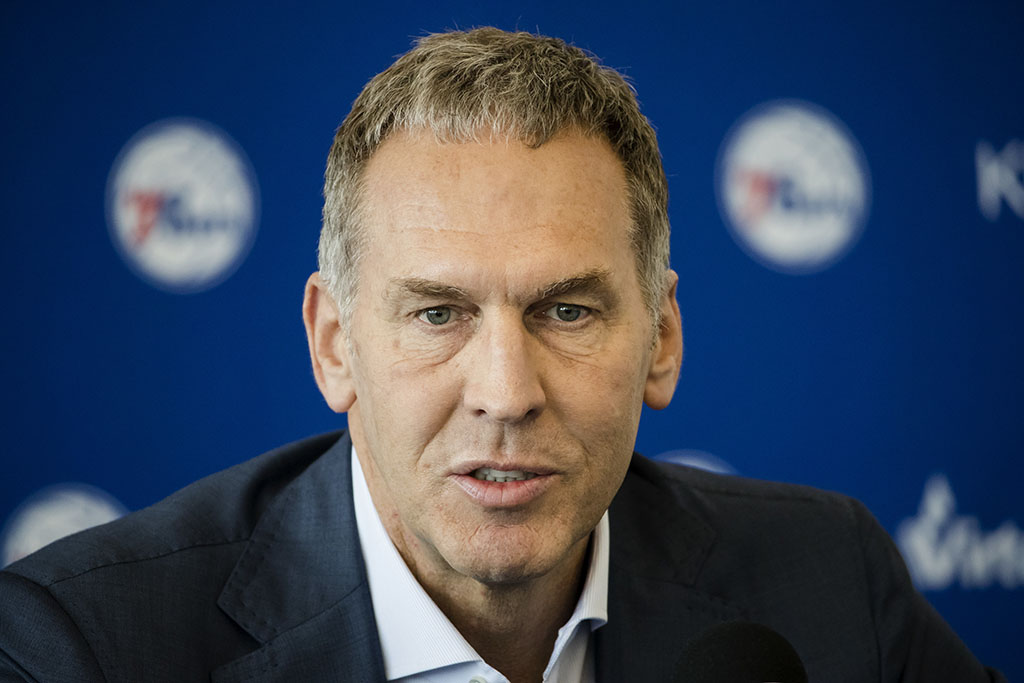 Philadelphia 76ers general manager Bryan Colangelo speaks during a news conference at the NBA basketball team's practice facility in Camden, N.J. Colangelo is denying a report connecting the executive to Twitter accounts that criticized Sixers players Joel Embiid and Markelle Fultz, among other NBA figures. The accounts also took aim at former Sixers GM Sam Hinkie, Toronto Raptors executive Masai Ujiri and former Sixers players Jahlil Okafor and Nerlens Noel, according to a report by The Ringer.
