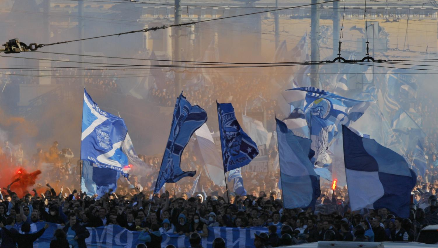 Zenit's fans march prior to their national soccer Championship in downtown St.Petersburg, Russia. Racist and anti-gay chants have become more common in Russian soccer as the country prepares to host the World Cup, even as overall incidents of discrimination declined.
