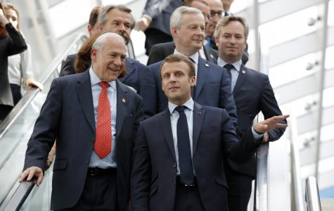 Macron on an escalator