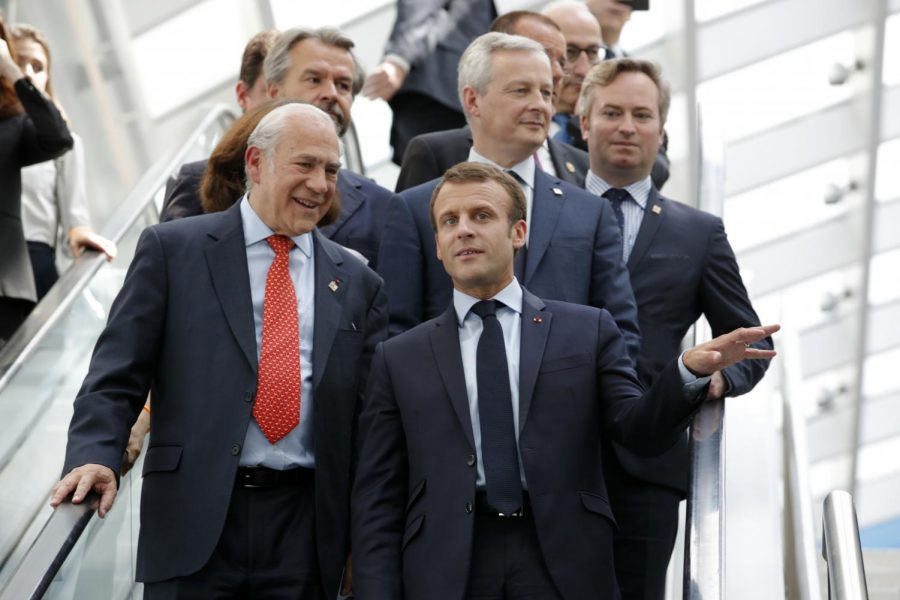 French+President+Emmanuel+Macron%2C+right%2C+and+OECD+Secretary-General+Angel+Gurria+arrive+at+a+meeting+in+Paris+on+Wednesday.+Macron+warned+against+trade+wars+in+an+impassioned+speech+about+international+cooperation+two+days+before+the+Trump+administration+decides+whether+to+hit+Europe+with+new+tariffs.