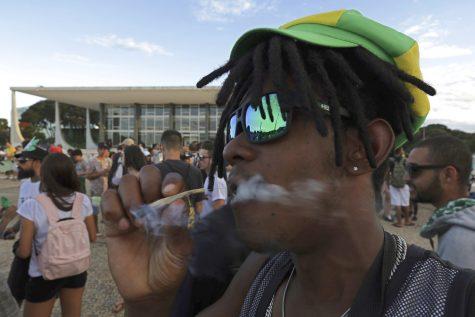 A young man smokes marijuana