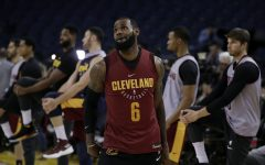 Cleveland Cavaliers' LeBron James watches his shot as his teammates stretch behind him during an NBA basketball practice, Wednesday, May 30, 2018, in Oakland, Calif. The Cavaliers face the Golden State Warriors in Game 1 of the NBA Finals on Thursday in Oakland. (AP Photo/Marcio Jose Sanchez)