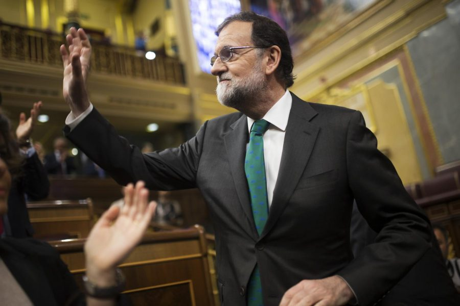 Spain's Prime Minister and Popular Party leader Mariano Rajoy gestures to his fellow lawmakers