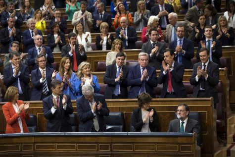 Spain's Prime Minister Mariano Rajoy, lower row right, is applauded by his fellow lawmakers