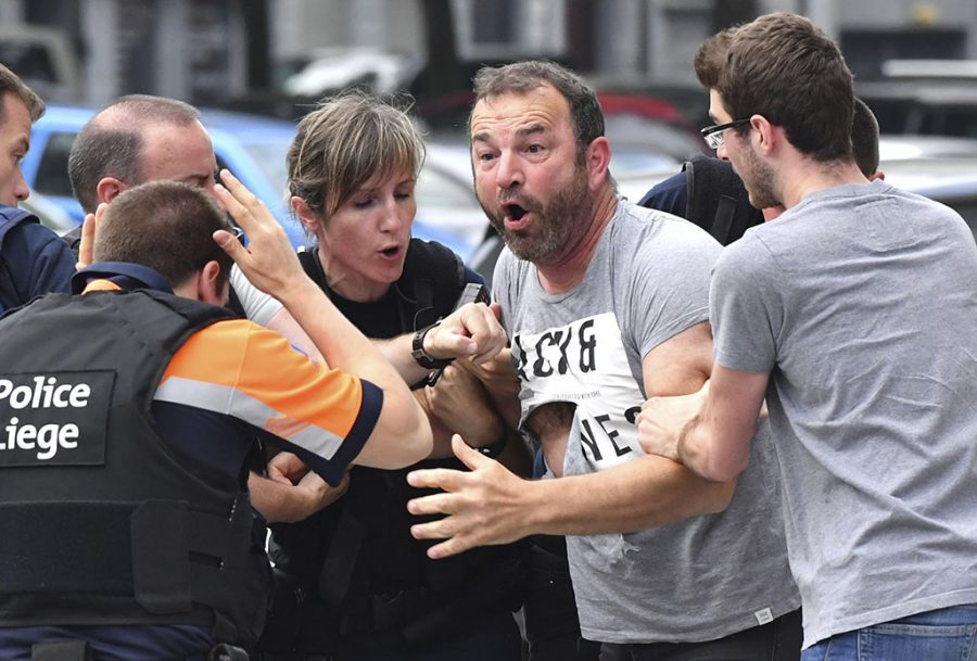 Belgium man being calmed by police
