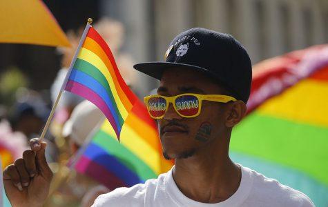 Man waving gay pride flag
