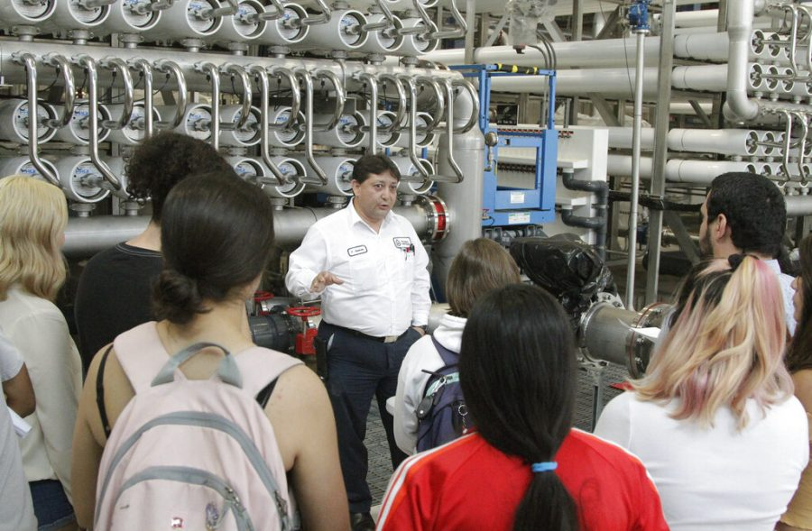 College students listen as El Paso Water worker Hector Sepulveda explains the desalination process May 2 at a plant in El Paso, Texas. The silver pipes push water through tightly packed membranes inside the white pipes, drawing minerals out of the brine. As the planet warms and weather patterns turn more extreme, droughts - as well as floods - in the state generally have worsened. El Paso, which has about 700,000 people living in a desert region that gets only 9 inches (23 centimeters) of rain annually, receives international groups wanting to learn more about innovative facilities like the largest inland desalination plant in the United States.
