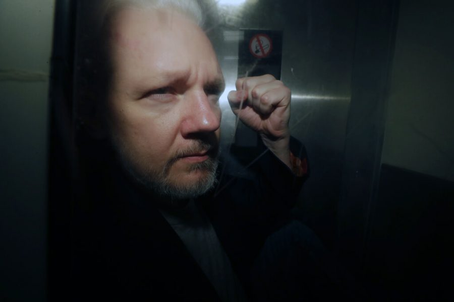 In+this+May+1%2C+2019%2C+file+photo%2C+WikiLeaks+founder+Julian+Assange+puts+his+fist+up+as+he+is+taken+from+court+in+London.+