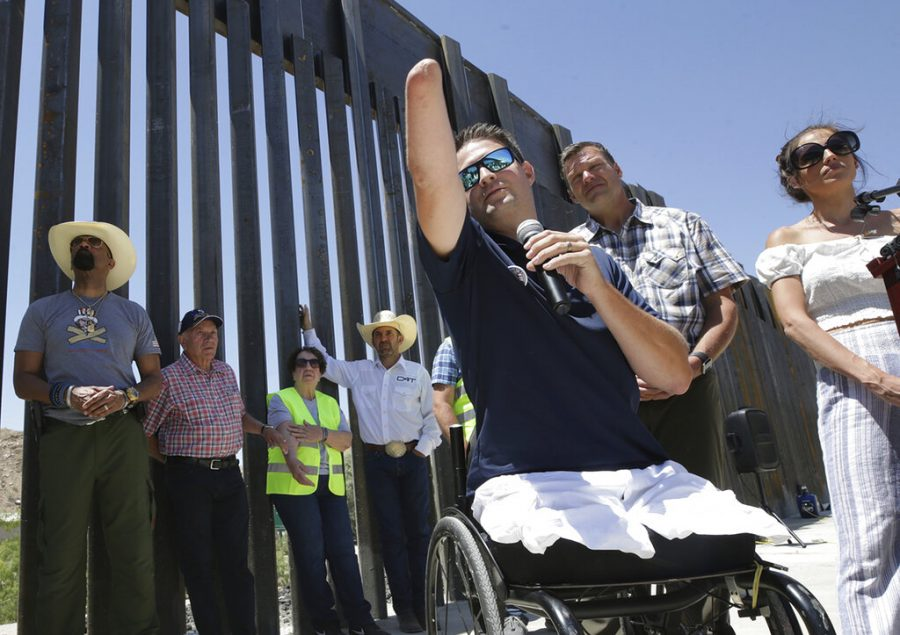 Brian Kolfage, founder of We Build the Wall Inc., speaks at a news conference Thursday, May 30, 2019, in Sunland Park, N.M., where a privately funded wall is being constructed. The New Mexico city is allowing construction to resume of the privately funded barrier along the U.S.-Mexico border following questions about its permit. (Mark Lambie/The El Paso Times via AP)