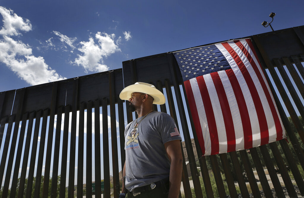 David Clarke Jr., a We Build the Wall Inc. board member, stands by a privately funded barrier, who arrived for a news conference in Sunland Park, N.M., Thursday, May 30, 2019.